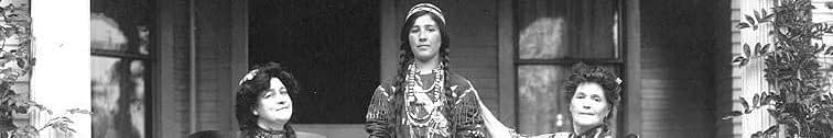 Caroline_Burke_and_friends_dressed_in_Native_American_costume_on_the_porch_of_her_home,_Seattle,_Washington,_1909_(AYP_88)